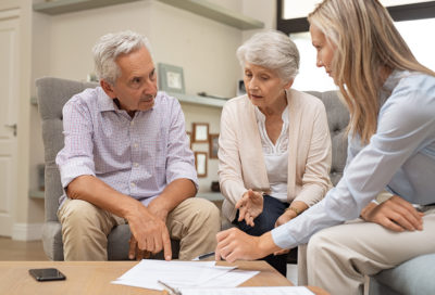 Older couple talking to life coach about end of life planning
