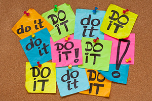 a bulletin board with notes that say do it